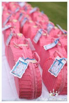 Tea set favors in baskets at a Alice in Wonderland Party #aliceinwonderland #favors