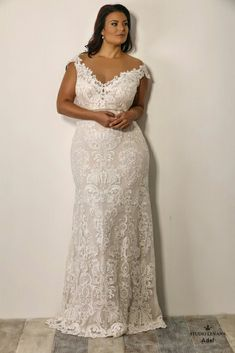 Sexy plus size wedding gown made of s stunning lace with off shoulder sleeves. Adel. Studio Levana