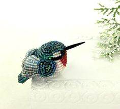 should have posted it on Birds!! LOve it!! Hummingbird Figurine Tiny Beaded RubyThroated by MeredithDada, $38.00