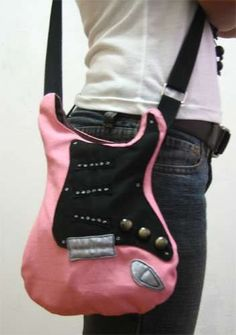 Make a rockin' guitar bag . Free tutorial with pictures on how to sew a guitar shaped bag in under 0 minutes by sewing with fabric, sewing machine, and buttons. Inspired by for boyfriends, for girlfriends, and shapes. How To posted by Myam. Sewing Hacks, Sewing Tutorials, Sewing Crafts, Sewing Projects, Sewing Patterns, Bag Tutorials, Diy Projects, Bag Patterns, Stitch Patterns