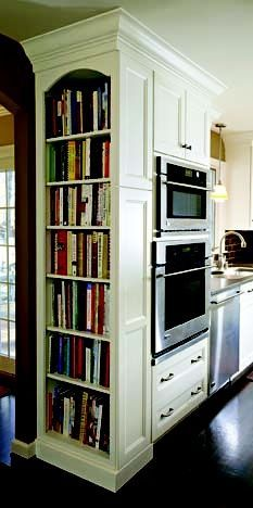 i love the idea of taking an empty wall off the kitchen and turning it into a built-in bookcase for cookbooks