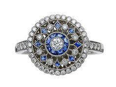 Platinum Round Diamond Calibre Sapphire cluster ring with Lozenge Sapphires