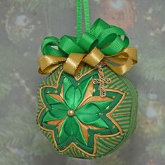 Green and Gold Handmade No Sew Quilted Ornament with a gold cross charm.