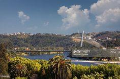 View of Queen Elisabeth bridge over Mondego river in Coimbra, Portugal.