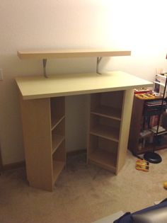 Billy Standing Desk - IKEA Hackers. Good idea with book storage. Just needs a tall chair for when sitting is necessary.