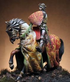 Excellent barding and heraldry on this 54mm knight miniature by Pegaso painted by Alfonsito.