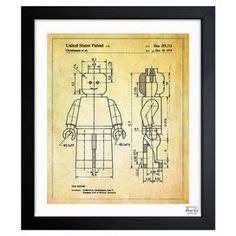 A nostalgic touch for your living room or den, this handsome print showcases a Lego-inspired patent drawing reproduction and sleek black frame. Made in the USA. Product: Framed printConstruction Material: Plexiglass, paper and woodColor: Black frameFeatures: Professionally hand-framedArrives ready to hang with all hardware includedMade in the USA Includes a certificate of authenticity by the artist Cleaning and Care: Dust lightly using a soft, clean, lint-free cotton cloth >