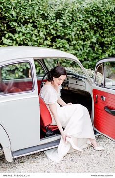 A modern take on a vintage wedding look with a vintage car and old fashioned wedding dress
