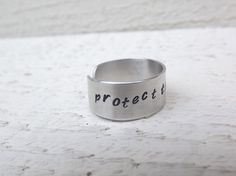 Protect this woman hand stamped silver aluminum cuff by Amayeli, $12.00