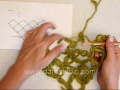DROPS Crochet Tutorial: How to work love knots triangle. In this DROPS video we show how to crochet a triangle of love knots. Love knots are inspired by the Celtic never-ending knots, the symbol of eternal love.   1 love knot: * Pull st on hook approx 4 cm / 1½'' long, yarn over hook , pull yarn through st, insert needle in loop behind the long st, yarn over, pull yarn through loop (= 2 sts on hook), yarn over, pull yarn over through both sts on hook *, from *-* = 1 love knot.