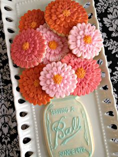 Zinnia flower cookies in a Ball Mason Jar cookie vase! Such a great presentation! Cookies by Cookies with Character.