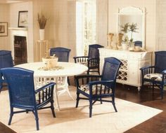 Male Fallacy: All Wood is Good - No White Rooms.  All white wicker furniture would have been too predictable.  This looks amazing, just by painting the chairs a cobalt blue.
