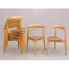 A set of six Hans Wegner for Fritz Hansen teak three legged stacking chairs with spade shape seat...