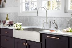 HiRise™ bridge kitchen faucet     HiRise sidespray     Vault™ under-mount apron-frontsink     When mixing metals balance cool and warm tones–such as this Brushed Stainless faucet and copper cabinet hardware–throughout the space.