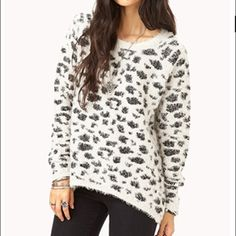 """HP 9/23Off-white leopard print eyelash sweater This sweater is very warm and has a high-low back design (the back covers your bottom). Worn once. 77% polyester, 23% acrylic, machine wash cold, dry flat, do not dry clean. Host Pick from """"Best in sweaters, jackets, and more"""" party on 9/23/15. Covershot from forever21.com Forever 21 Sweaters Crew & Scoop Necks"""