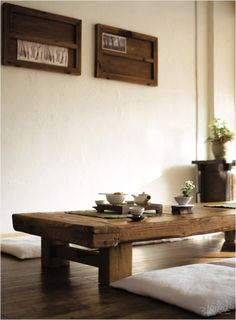 Wooden table arranged with traditional tea set.