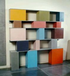 Painter cinder blocks and wood planks for colorful shelving