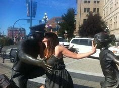 """""""Back off little girl, he's mine!"""" Apparently this young woman dreams of stealing fathers from little girls, she acts out her fantasy (full force!) on this city statue. While this scene would be cause for concern in real life, it is hilarious when mimicked with statues."""