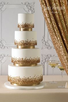 GLISTEN & GLAM GOLD SEQUIN Wedding Cake by The Cake Parlour. Suspended tiers embellished with gold sequins and ribbon.