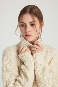 Winter Style Ideas. Winter Fashion and Winter Outfit Ideas. Ivory Fisherman's knit turtleneck sweater.
