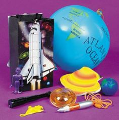Outer Space Filled Loot Bag :   Out of this World!  Surprise your guests with these cool treats - each decorated paper bag contains 8-9 assorted gift items.  Bag:10.2 cm x 7.62 cm x 20.3 cm.