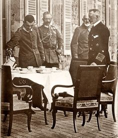 Imperial Germany's Kaiser Wilhelm II (next to servant) with Prince Heinrich (naval uniform)  and General von Heeringen prepare to have coffee on the veranda, photo taken possibly c. 1910. Four years later Wilhelm took Germany into WW1.
