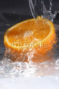 Fresh orange , water splash