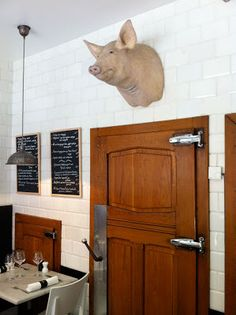 Viva M' Boma Bruxelles. Restaurant door with Head of pig