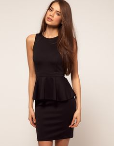 I wonder if I can pull off the peplum dress...love the open back!