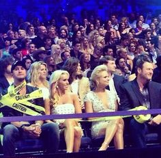 Luke and Caroline Bryan with Miranda Lambert and Blake Shelton after luke bryan fell off the stage @ one of his concerts