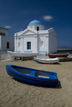 Mykonos Synagogue, Greece. It looks almost like you'd expect it to look -- white stucco with a painted blue dome -- because it's in Greece. :)