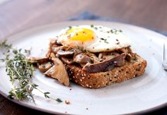 Sauteed mushrooms in a light cream sauce served on garlic bread with fried eggs. Pretty much the perfect breakfast.