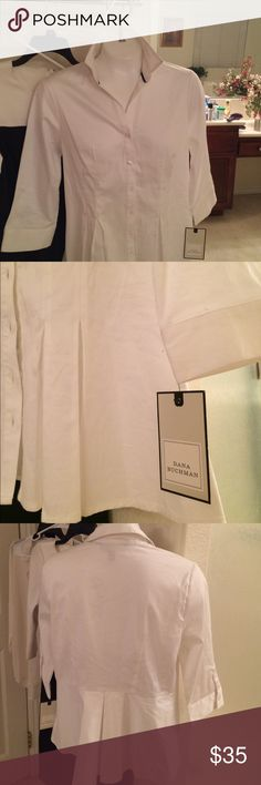 """👚 White Top with Black piping along collar Button Down shirt with buttons on each wrist. Cotton and Spandex make for a stretch my sateen feel. Tried on..never worn waist 27-28"""" hips 37-38"""" Dana Buchman Tops Button Down Shirts"""