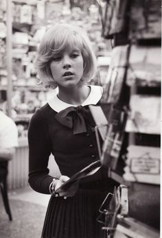 Sylvie Vartan browsing for postcards in Paris, circa 1964.