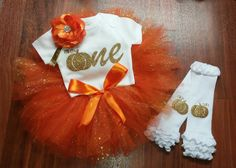 Girls First Birthday 4-piece outfit. Comes with tutu, leg warmers, onesie and headband. You have the choice of all 4 pieces, just the tutu or no leg warmers. Colors of the tutu are orange, sparkly orange and polka dot orange. Tutu is 3 layers.  **TUTU DOES HAVE LOOSE GLITTER**  This tutu is 7 inches long. If you would like longer or shorter please message me.  I do customize tutus, so if you would like different colors just message me with your choice of colors - will do up to 4 different…