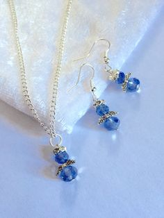 A personal favourite from my Etsy shop https://www.etsy.com/listing/221851591/blue-glass-angel-pendant-and-earrings