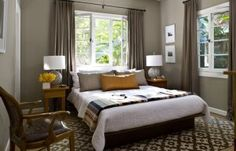 jeff andrews design grey brown bedroom taupe drapes windows