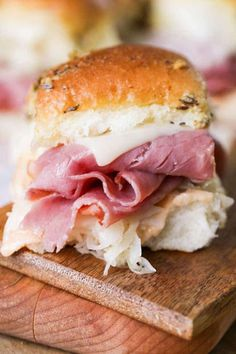 Reuben Sandwich Sliders make the perfect party food! Dinner rolls with all of your favorite Reuben sandwich fillings, and a seasoned buttery topping.