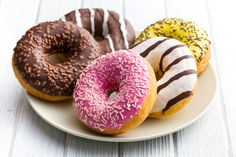 Iced doughnuts or glazed doughnuts are doughnuts which have a topping of icing put on them. Krispy Kreme's original doughnuts are glazed with a thin layer ...