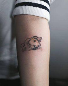 Cat tattoo on the left inner forearm.