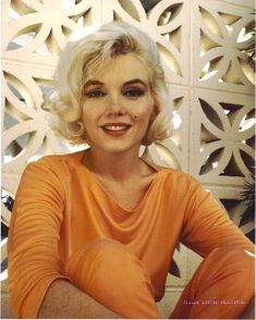"June 1962 Photographer George Barris photo shoot of Marilyn Monroe at Tim Leimert house. ""Pucci"" sitting. Pucci orange 043/1a. Image 24-41"