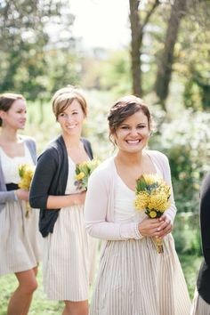 Bridesmaids wore - cute summery dresses from Anthropologie with adorable cardigans. The bride even donned her own mustard yellow sweater for some of the personal pics. On SMP: http://www.StyleMePretty.com/2014/03/03/fall-wedding-at-sycamore-farm-bloomington/ Bryce Covey