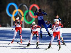 Marit Bjoergen, Therese Johaug and Heidi Weng (Norway) in the skiathlon by Richard Heathcote/Getty Images