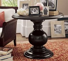 Love these large, round pedestal tables.  Always liked the idea of one of these in a bedroom next to the bed.