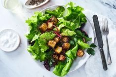Roasted potatoes dress up as seasoned croutons with a crispy, cheesy, herby crust.