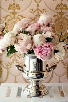 silver champagne bucket filled with spring peonies