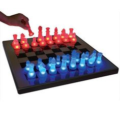 LumiSource LED Glow Chess Set - Ever get stuck while playing? Illuminate your next move with the LumiSource LED Glow Chess Set . This uniquely futuristic chess set features cool. Acrylic Board, Best Gifts For Him, Translucent Glass, Chess Pieces, Red Led, The Ordinary, Board Games, Glow, Blue And White