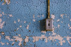Wall outlet in an abandoned building.