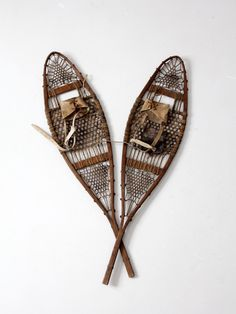 A pair of early vintage snowshoes. This unique elongated set of snowshoes (trail style) are in great condition with the original leather bindings. A beautiful addition for your chalet wall! - early Am