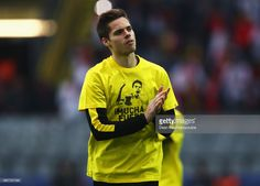 Julian Weigl of Borussia Dortmund wears a shirt for Marc Bartra who was injured in the team coach attack prior to the UEFA Champions League Quarter. Julian Weigl, Marc Bartra, Signal Iduna, As Monaco, Team Coaching, Uefa Champions League, Finals, Soccer, Hot